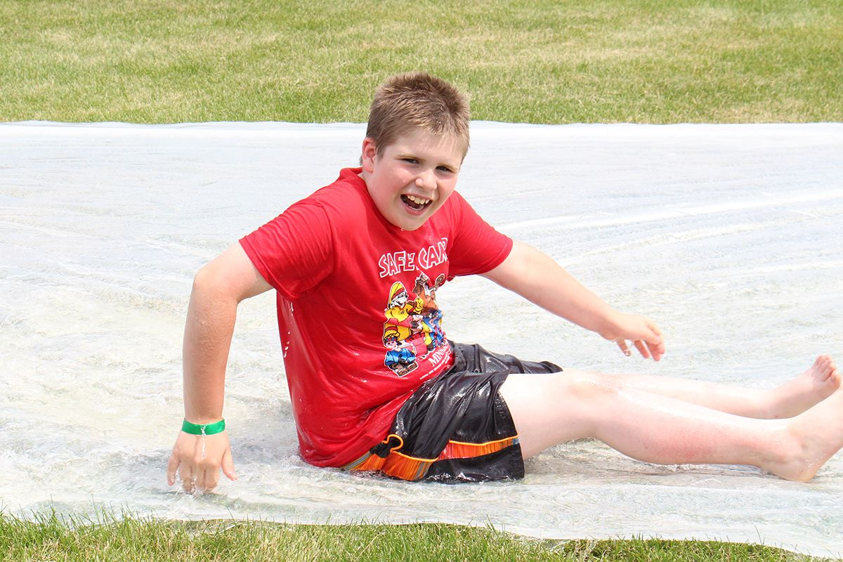 boy on giant slip n slide